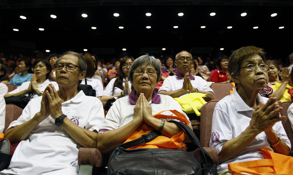 Photo - People offer prayers during a mass prayer for the missing Malaysia Airlines Flight MH370, in Kuala Lumpur, Malaysia, Sunday, April 6, 2014. The head of the multinational search for the missing Malaysia airlines jet says that electronic pulses reportedly picked up by a Chinese ship are an encouraging sign but stresses they are not yet verified. (AP Photo/Lai Seng Sin)