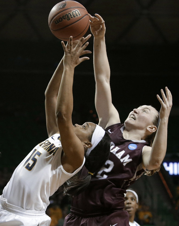 Photo - California's Brittany Boyd (15) and Fordham's Abigail Corning (42) compete for a rebound in the second half of a first-round game in the NCAA women's college basketball tournament, Saturday, March 22, 2014, in Waco, Texas. California won 64-63. (AP Photo/Tony Gutierrez)