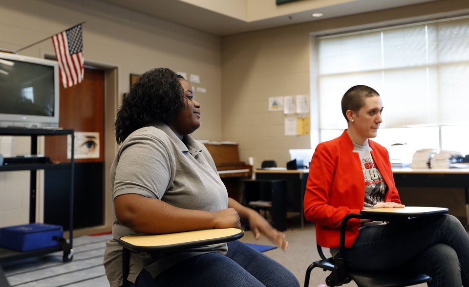 Ninetta Rogers, left, and Taylor Forester talk about issues during a gay-straight student group meeting at U.S. Grant High School. PHOTO BY SARAH PHIPPS, THE OKLAHOMAN <strong>SARAH PHIPPS - SARAH PHIPPS</strong>