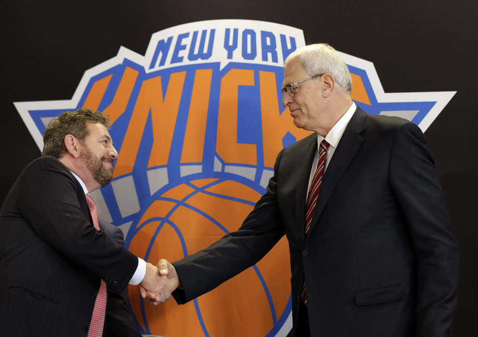 Photo - New York Knicks new team president Phil Jackson, right, shakes hands with Madison Square Garden Chairman James Dolan during a news conference where he was introduced, at New York's Madison Square Garden, Tuesday, March 18, 2014. (AP Photo/Richard Drew)