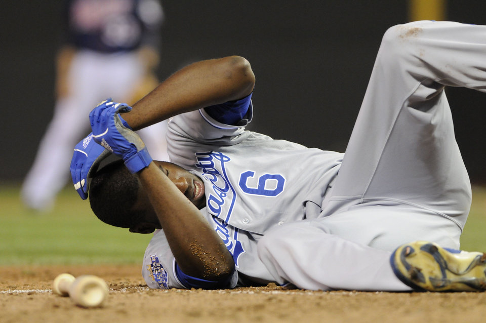 Photo -   Kansas City Royals' Lorenzo Cain falls to the ground after getting hit in the helmet by a pitch from Minnesota Twins' Luis Perdomo in the eighth inning of a baseball game, Tuesday, Sept. 11, 2012, in Minneapolis. (AP Photo/Jim Mone)
