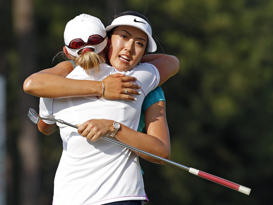Photo - Michelle Wie, right, hugs runner-up Stacy Lewis, after winning the U.S. Women's Open golf tournament in Pinehurst, N.C., Sunday, June 22, 2014. (AP Photo/John Bazemore)