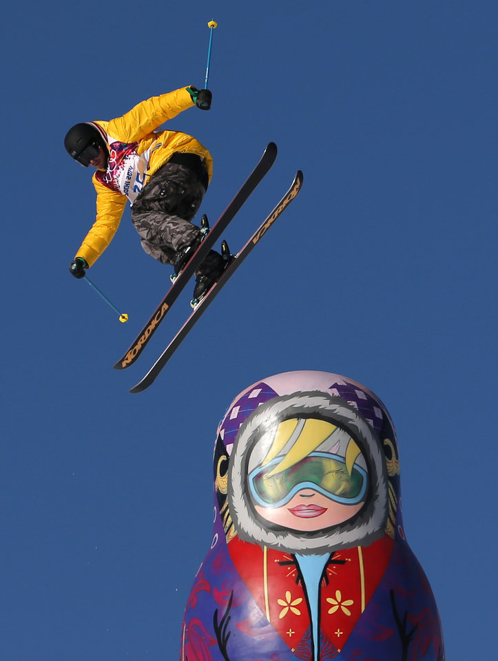 Photo - Germany's Benedikt Mayr competes in the men's ski slopestyle qualifying at the Rosa Khutor Extreme Park, at the 2014 Winter Olympics, Thursday, Feb. 13, 2014, in Krasnaya Polyana, Russia. (AP Photo/Sergei Grits)