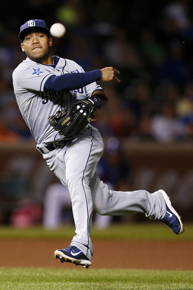Photo - San Diego Padres shortstop Alexi Amarista is late on the throw as the Chicago Cubs' Emilio Bonifacio reaches first on a single during the seventh inning of a baseball game on Wednesday, July 23, 2014, in Chicago. (AP Photo/Andrew A. Nelles)