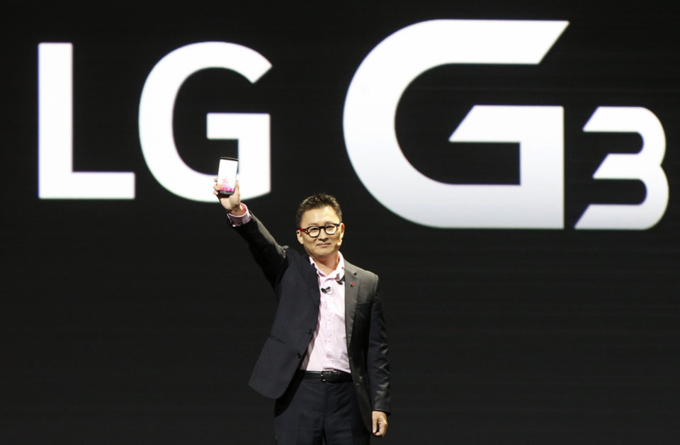 Photo - Dr. Ramchan Woo, Head of Smartphone Planning for LG, unveils the company's new smartphone called G3 at a press event in London, Tuesday, May 27, 2014. (AP Photo/Lefteris Pitarakis)