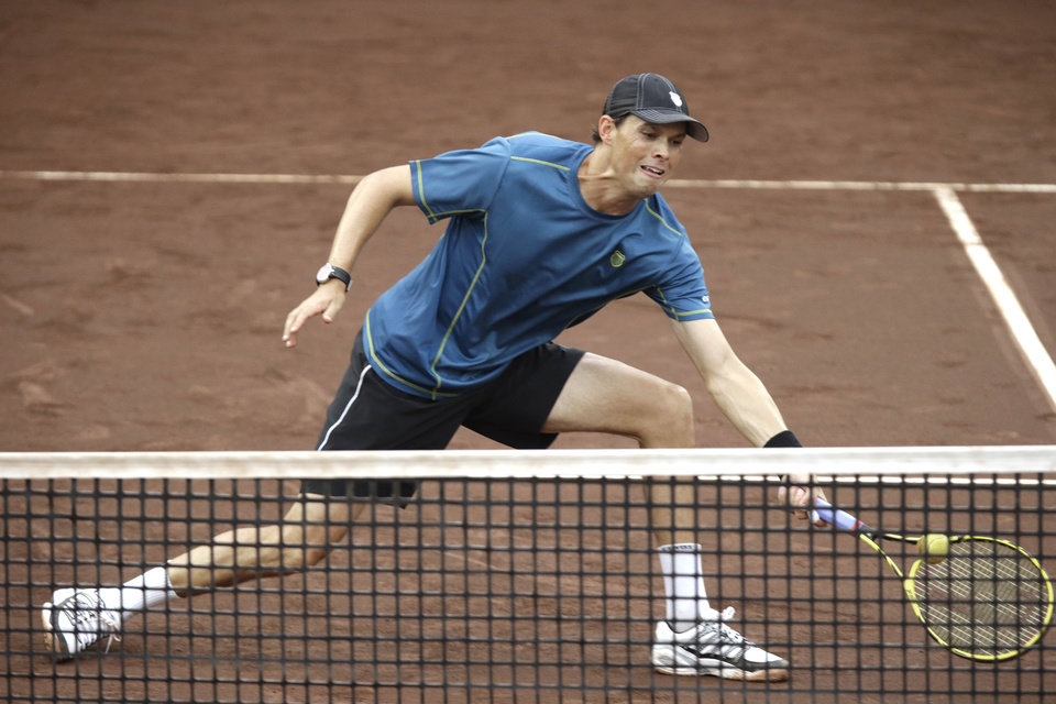 Photo - Bob Bryan goes to the net as he and Mike Bryan play in the doubles final against Spain's David Marrero and Fernando Verdasco at the U.S. Men's Clay Court Championship tennis tournament Saturday, April 12, 2014, in Houston. (AP Photo/Pat Sullivan)