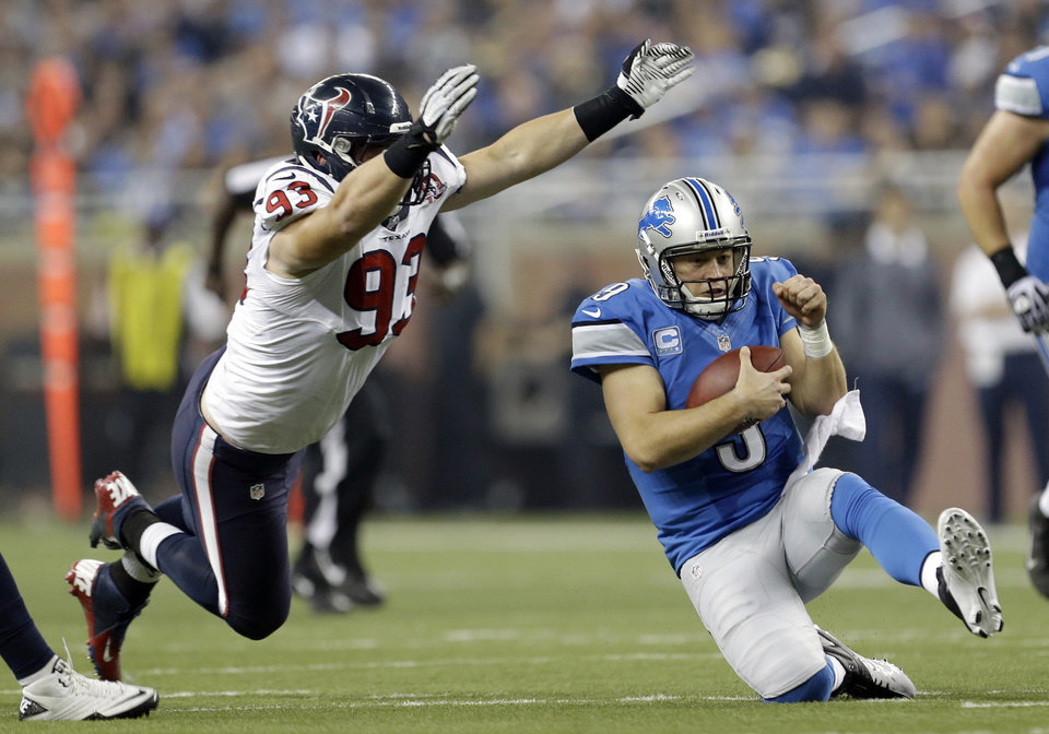 Photo -   Detroit Lions quarterback Matthew Stafford (9) slides after scrambling away from Houston Texans defensive end Jared Crick (93) during the fourth quarter of an NFL football game at Ford Field in Detroit, Thursday, Nov. 22, 2012. (AP Photo/Paul Sancya)