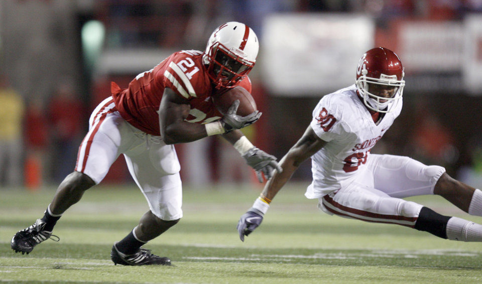 Photo - Nebraska's Prince Amukamara (21) intercepts a pass in front of OU's Adron Tennell (80) during the first half of the college football game between the University of Oklahoma Sooners (OU) and the University of Nebraska Cornhuskers (NU) on Saturday, Nov. 7, 2009, in Lincoln, Neb. Photo by Sarah Phipps, The Oklahoman