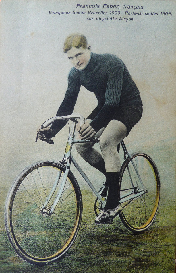 Photo - In this 1909 illustration provided by the Collection of Ivan Bonduelle, French cyclist and 1909 Tour de France winner Francois Faber with his bike. Three former winners of the Tour de France; Octave Lapize, Francois Faber and Lucien Petit-Breton all died fighting in World War I. Faber died in 1915. (AP Photo/Collection Privee Ivan Bonduelle)