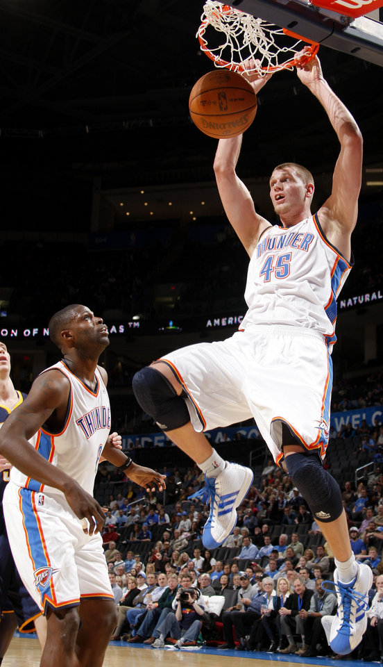 Photo - Oklahoma City's Cole Aldrich (45) dunks the ball beside Nazr Mohammed (8) during the NBA basketball game between the Oklahoma City Thunder and the Indiana Pacers at the Oklahoma City Arena, Wednesday, March 2, 2011. Photo by Bryan Terry, The Oklahoman