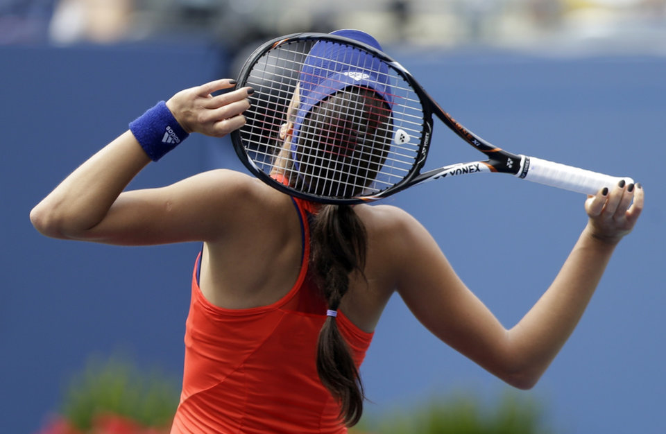 Photo - Ana Ivanovic, of Serbia, reacts after losing a point to Victoria Azarenka, of Belarus, during the quarterfinals of the 2013 U.S. Open tennis tournament, Tuesday, Sept. 3, 2013, in New York. (AP Photo/Julio Cortez)