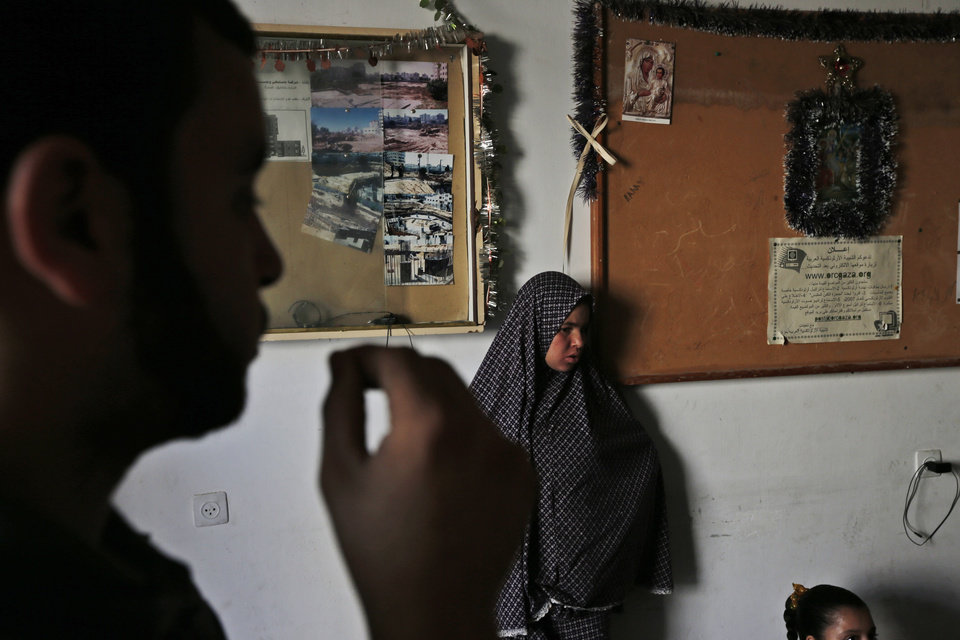 Photo - Palestinians take shelter inside the St. Porphyrios Church in Gaza City, Wednesday, July 23, 2014. Muslim families driven from their homes by the fierce fighting between Israel and Hamas are observing Ramadan in Gaza City's Greek Orthodox church. (AP Photo/Lefteris Pitarakis)