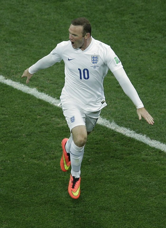 Photo - England's Wayne Rooney celebrates scoring his side's first goal during the group D World Cup soccer match between Uruguay and England at the Itaquerao Stadium in Sao Paulo, Brazil, Thursday, June 19, 2014.  (AP Photo/Michael Sohn)