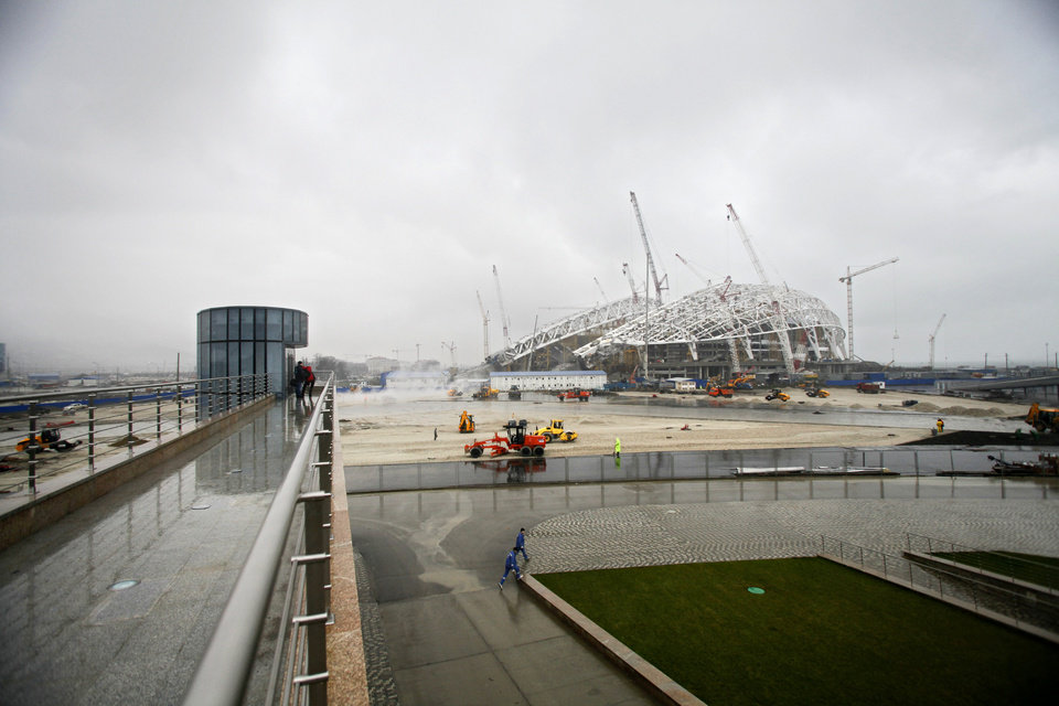 Photo - FOR STORY RUSSIA SOCHI YEAR TO GO - In this photo dated Wednesday, Jan. 30, 2013,  The main Olympic stadium is seen under construction at the Russian Black Sea resort of Sochi, with just one year till the opening ceremony of the winter Olympic 2014 Sochi Games.  The Black Sea resort of Sochi is a vast construction site sprawling for nearly 40 kilometers (25 miles) along the coast and 50 kilometers (30 miles) up into the mountains, with no escape from the clang and clatter of the construction works, the drilling, jack-hammering and mixing of cement. (AP Photo/Igor Yakunin)
