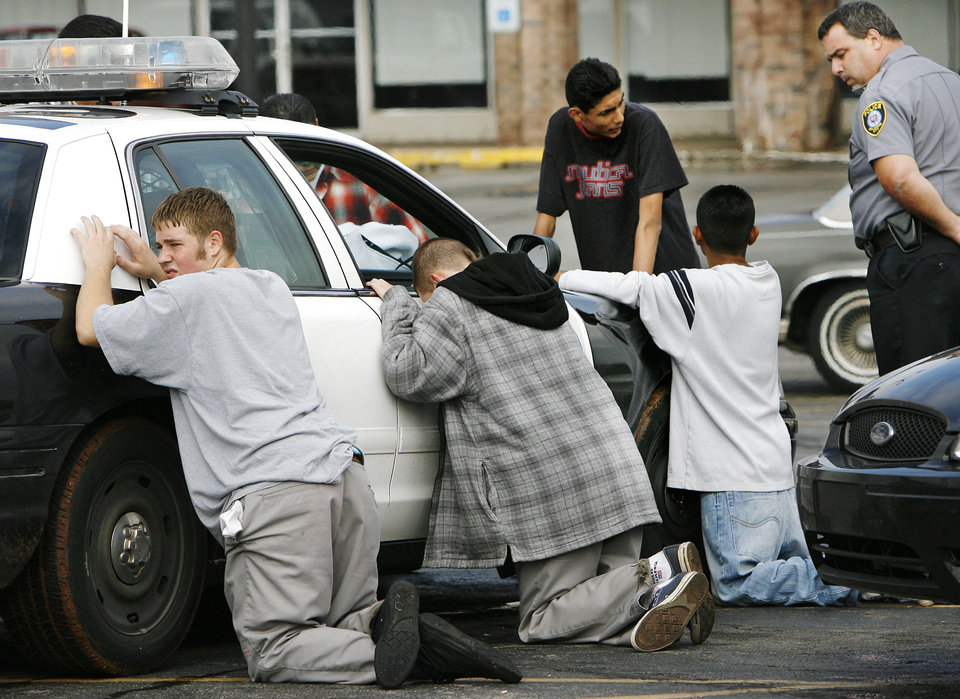 Oklahoma City police officers detained at least 6 young males for questioning about gang activity and a reported fight near U.S. Grant High School around 2:15 PM, Monday,  Oct. 16, 2006.    By Jim Beckel /The Oklahoman.