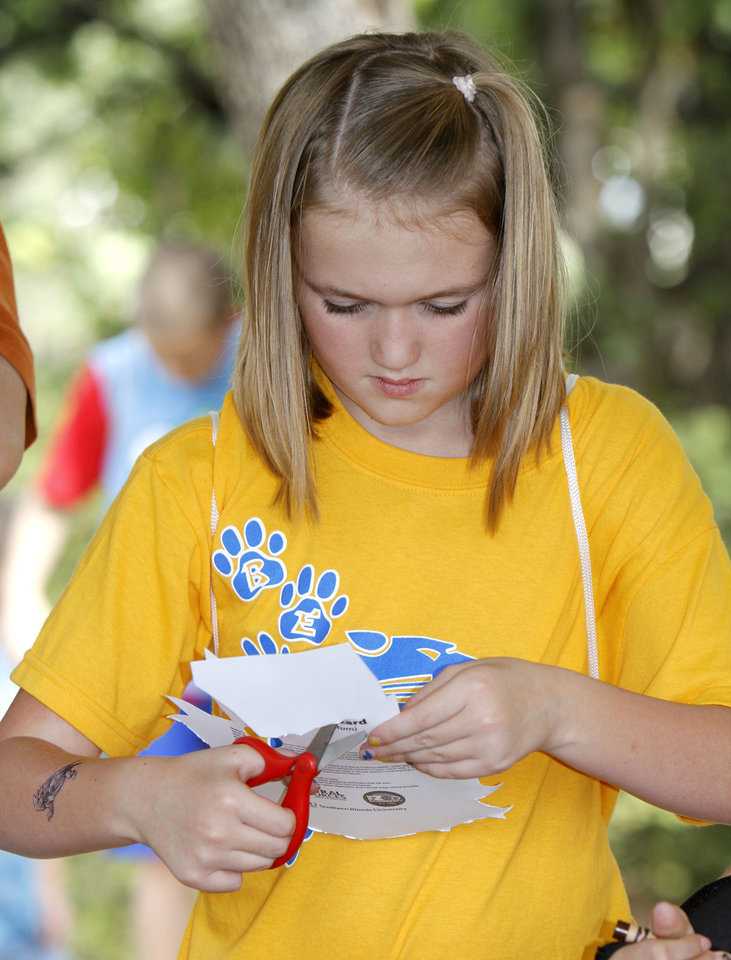 Photo - Summer Jenks, from Bethel Acres School, creates a Horned Lizard mask in the OKC Zoo booth, during school day of the Oklahoma Wildlife Expo at the Lazy E Arena and Ranch in Guthrie, OK, Friday, September 28, 2012,  By Paul Hellstern, The Oklahoman