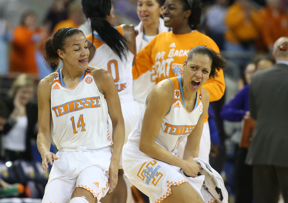 Photo - Tennessee guard Andraya Carter (14) and forward Cierra Burdick (11) celebrate a play in Tennessee's win over LSU in an NCAA college basketball game in the quarterfinals of the Southeastern Conference women's tournament, Friday, March 7, 2014, in Duluth, Ga. Tennessee defeated LSU 77-65. (AP Photo/Jason Getz)