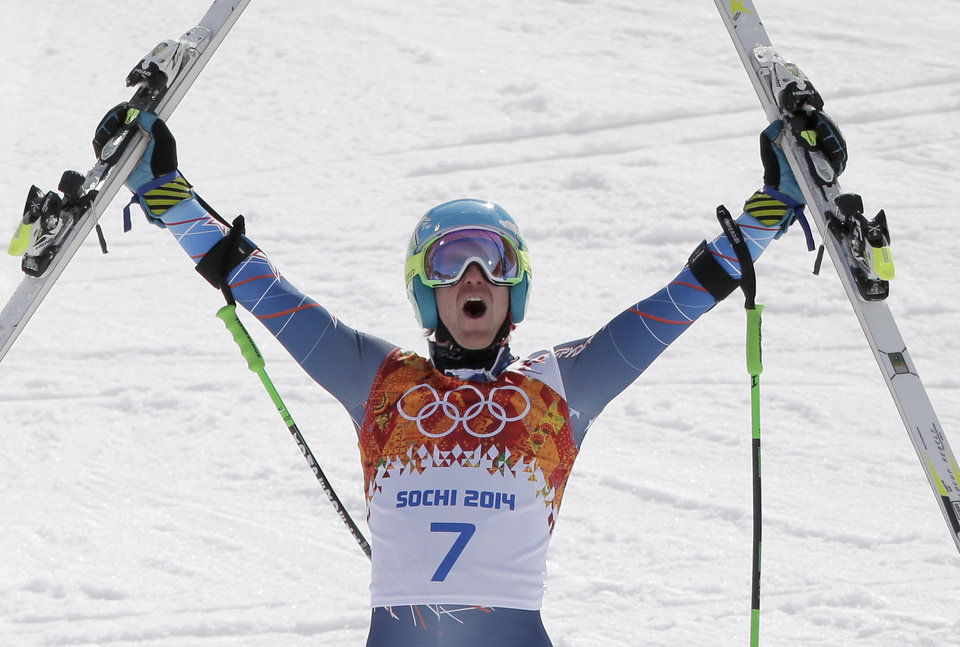 Photo - United States' Ted Ligety celebrates after winning the gold medal in the men's giant slalom at the Sochi 2014 Winter Olympics, Wednesday, Feb. 19, 2014, in Krasnaya Polyana, Russia.(AP Photo/Charlie Riedel)