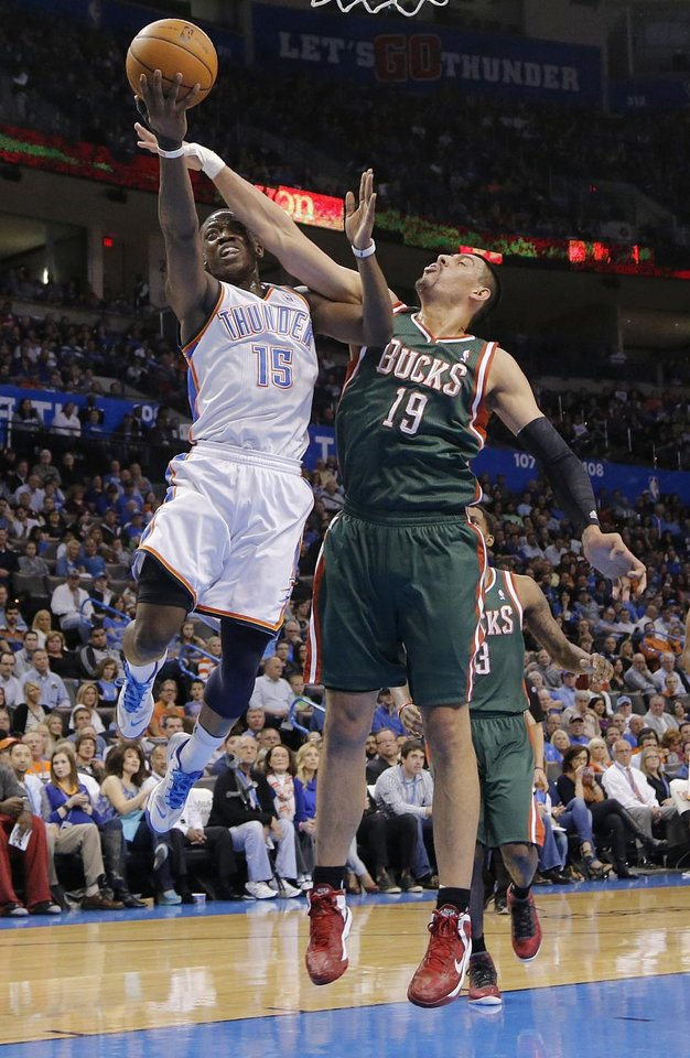Oklahoma City\'s Reggie Jackson (15) drives past Milwaukee \'s Gustavo Ayon (19) during the season finally NBA basketball game between the Oklahoma City Thunder and the Milwaukee Bucks at Chesapeake Energy Arena on Wednesday, April 17, 2013, in Oklahoma City, Okla. Photo by Chris Landsberger, The Oklahoman