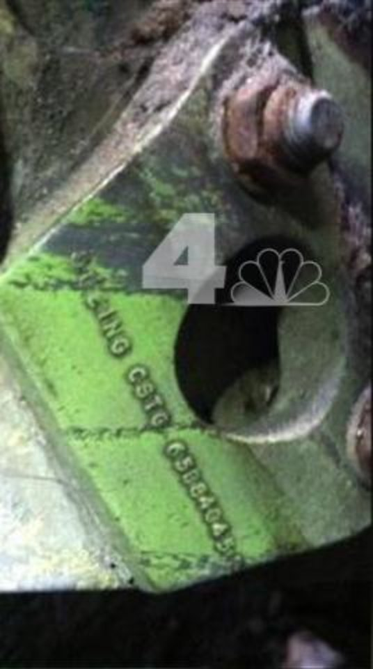 Photo - In this April 26, 2013 photo provided by WNBC-TV in New York, a section of wreckage from a landing gear bearing a Boeing serial number is shown. The landing gear was found wedged in between two New York City buildings not far from the World Trade Center construction site. It's believed to be from one of the airliners that were crashed into the World Trade Center in the terrorist attacks of September 11, 2001. (AP Photo/WNBC-TV) MANDATORY CREDIT   NO SALES