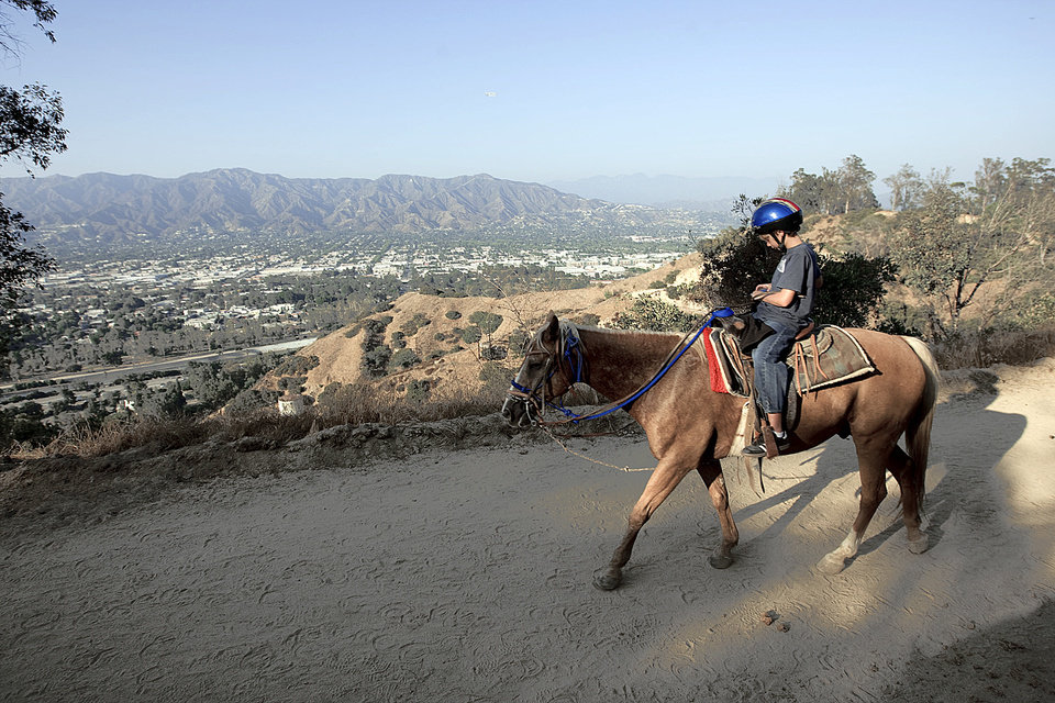 Drew Shumard from Atlanta takes a horseback ride to Griffith Park in Los Angeles.AP PHOTO