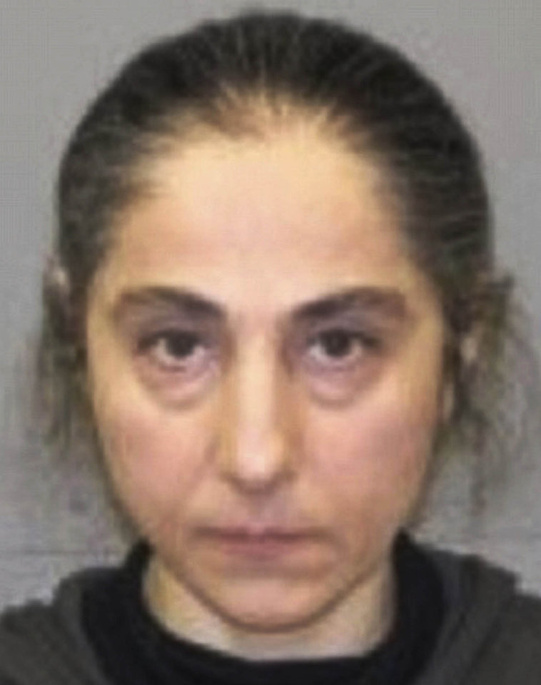Photo - This June 2012 booking photo released by the Natick, Mass., police shows Zubeidat K. Tsarnaeva, mother of Tamerlan and Dzhokhar Tsarnaev, the two men who set off bombs near the Boston Marathon finish line Monday, April 15, 2013 in Boston. Zubeidat Tsarnaeva was arrested in June 2012 on a shoplifting charge at a Lord & Taylor store in Natick.  (AP Photo/Natick Police Department)