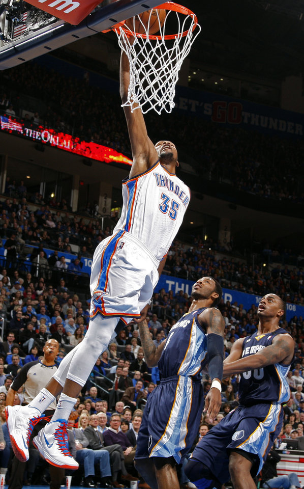 Oklahoma City\'s Kevin Durant (35) dunks over Memphis\' Chris Johnson (4) and Darrell Arthur (00) during the NBA basketball game between the Oklahoma City Thunder and the Memphis Grizzlies at the Chesapeake Energy Arena in Oklahoma City, Thursday, Jan. 31, 2013.Photo by Sarah Phipps, The Oklahoman