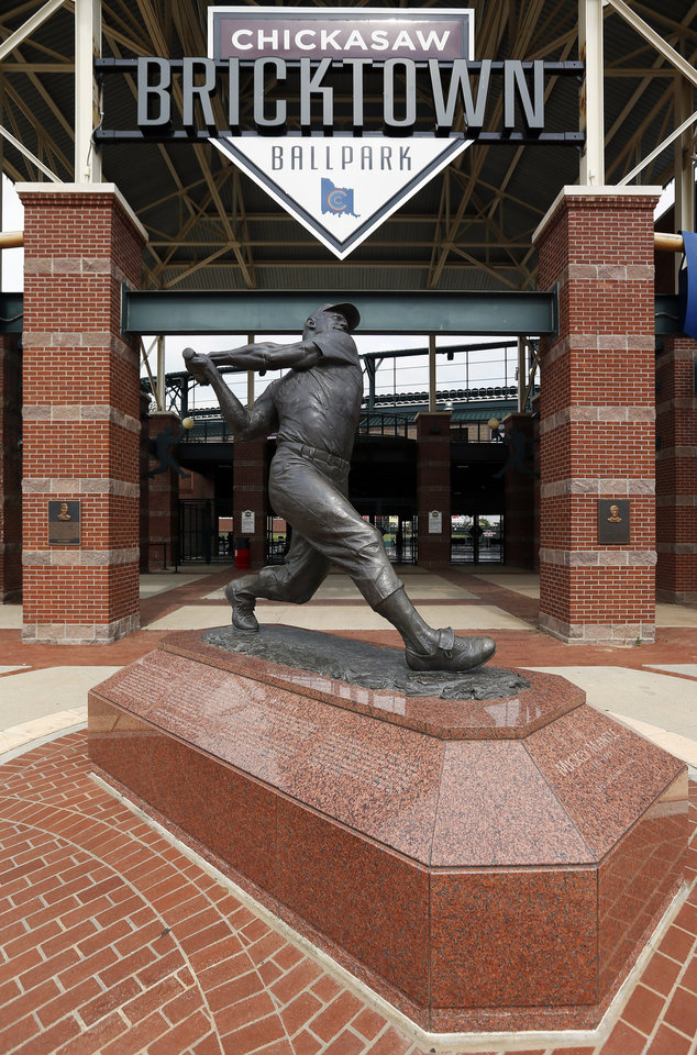 Photo - The Mickey Mantle statue in front of an entrance to the Chickasaw Bricktown Ballpark in downtown Oklahoma City. Photo by Nate Billings, The Oklahoman