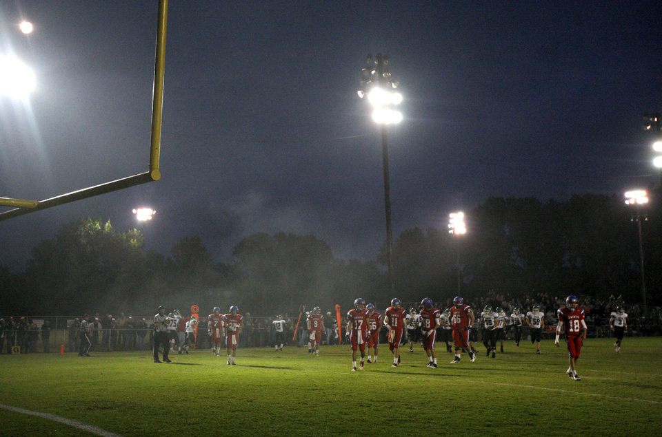 The Oklahoma Christian School (OCS)  football team takes the field against Jones during a high school football game in Edmond, Friday, September 14, 2012. Photo by Bryan Terry, The Oklahoman