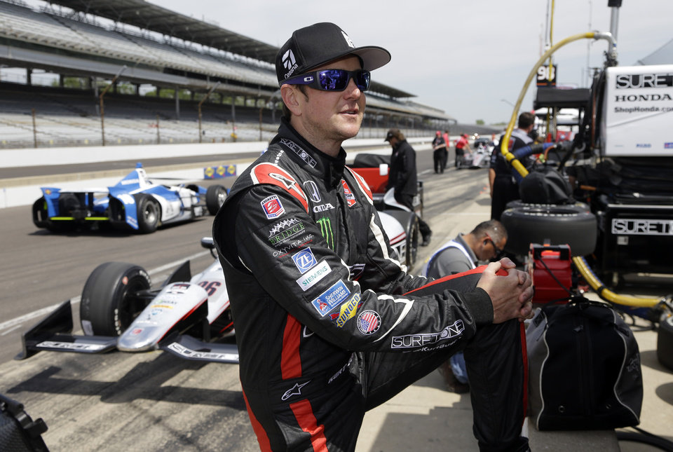 Kurt Busch stretches before the start of practice for the Indianapolis 500 IndyCar auto race at the Indianapolis Motor Speedway in Indianapolis, Monday, May 19, 2014. (AP Photo/Michael Conroy)