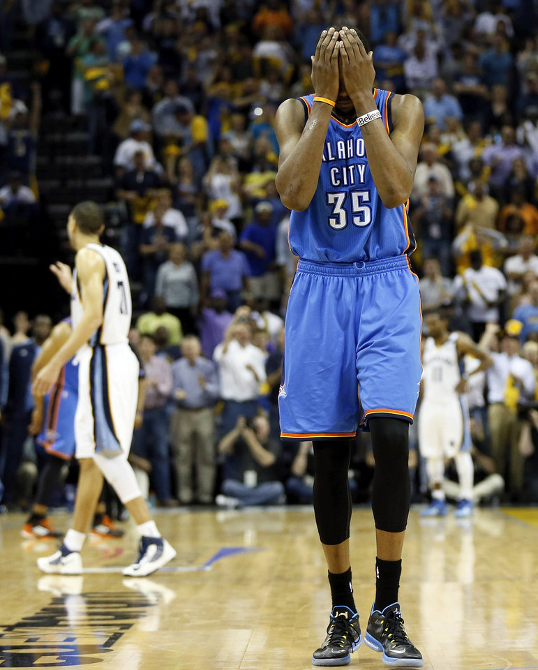 Photo - Oklahoma City's Kevin Durant (35) reacts after Memphis' Tony Allen (9) stole a Thunder inbounds pass with 21.1 second left in overtime during Game 4 of the second-round NBA basketball playoff series between the Oklahoma City Thunder and the Memphis Grizzlies at FedExForum in Memphis, Tenn., Monday, May 13, 2013. Memphis won 103-97 in overtime. Photo by Nate Billings, The Oklahoman
