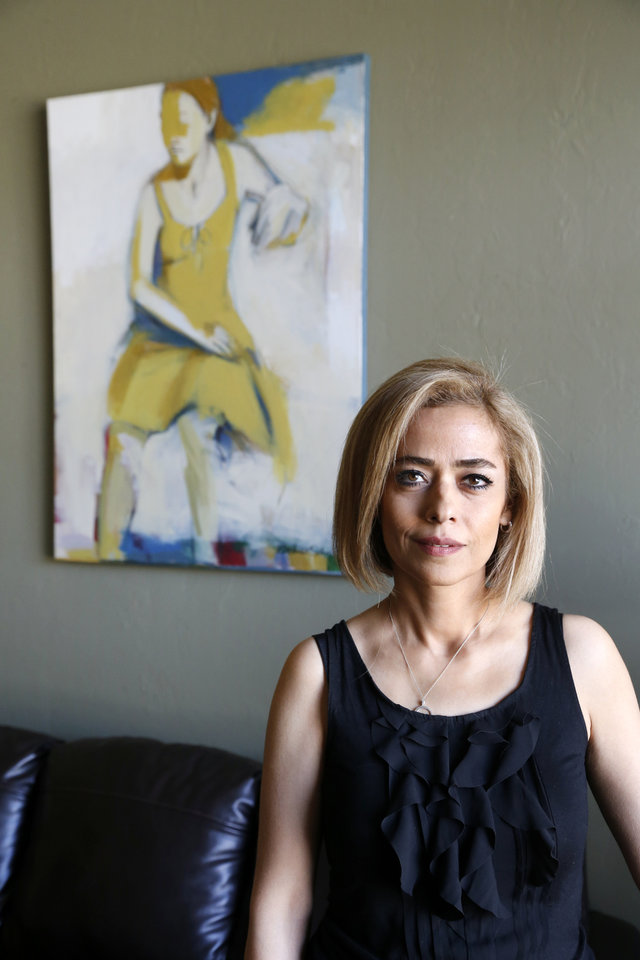 Photo - Painter Behnaz Sohrabian, who moved to Oklahoma from Iran in 2010, poses for a photo at her home in Edmond, Okla., Sunday, April 27, 2014. Photo by Nate Billings, The Oklahoman