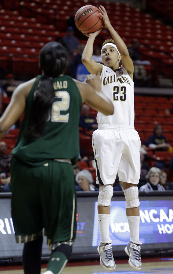 Photo - California guard Layshia Clarendon (23) shoots over South Florida center Akila McDonald (32) during the first half of a second-round game in the women's NCAA college basketball tournament in Lubbock, Texas, Monday, March 25, 2013. (AP Photo/LM Otero)
