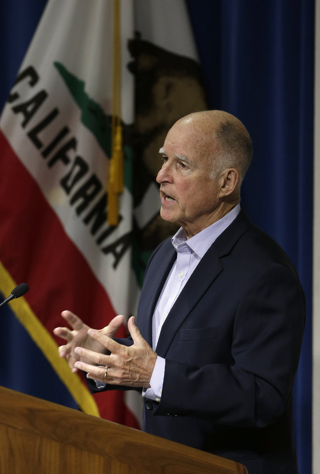Photo - Gov. Jerry Brown discusses the effects of climate change during his appearance before the University of California  Giannini Foundation of Agricultural Economics conference in  Sacramento, Calif., Monday, May 19, 2014.(AP Photo/Rich Pedroncelli)