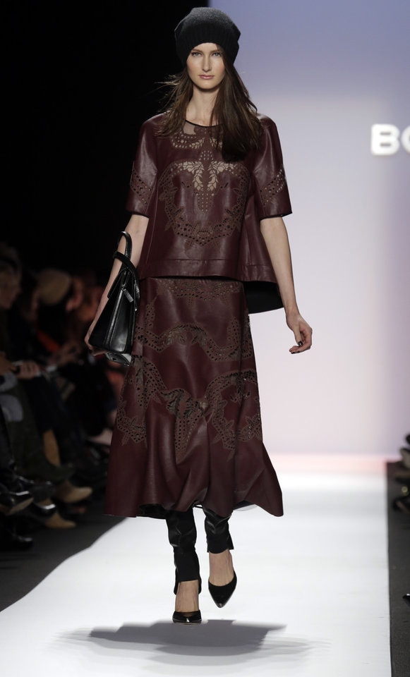 Photo - The BCBG Max Azria Fall 2013 collection is modeled during Fashion Week in New York on Thursday, Feb. 7, 2013. (AP Photo/Richard Drew)