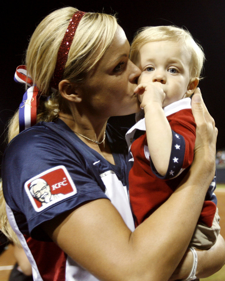 Jennie Finch kisses her son Ace Daigle following the World Cup of Softball game between USA and Japan at ASA Softball Stadium in Oklahoma City, Monday, July 16, 2007. By Matt Strasen, The Oklahoman