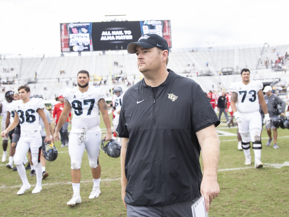 Photo - Central Florida head coach Josh Heupel walks off the field with a 44-29 victory over Houston in an NCAA college football game in Orlando, Fla., Saturday, Nov. 2, 2019. (Photo/Willie J. Allen Jr.)