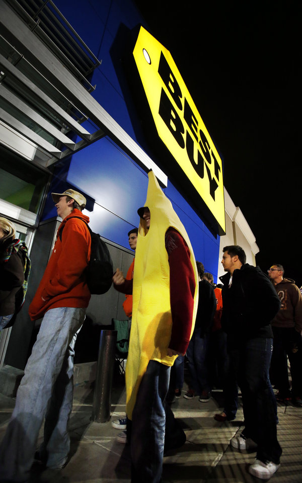 Deven Thompson moves to the door dressed as a banana after midnight for Black Friday Sales at Best Buy on Interstate 240 on Friday, Nov. 23, 2012, in Oklahoma City, Okla.  Photo by Steve Sisney, The Oklahoman