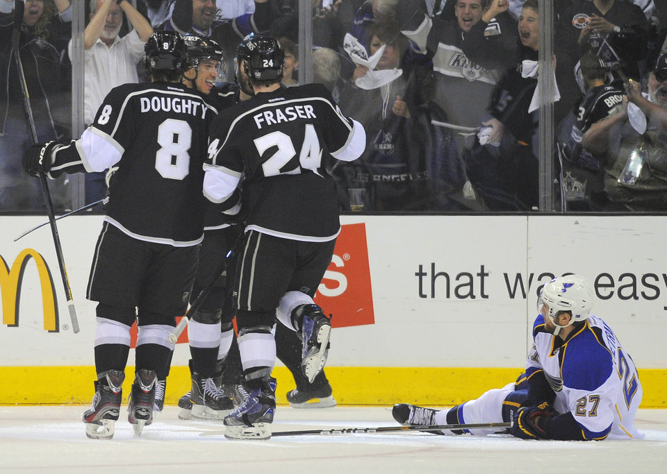 Photo -   Los Angeles Kings center Jordan Nolan, second from left, celebrates his goal with Drew Doughty, left, and center Colin Fraser as St. Louis Blues defenseman Alex Pietrangelo lies on the ice during the first period in Game 4 of an NHL hockey Stanley Cup second-round playoff series, Sunday, May 6, 2012, in Los Angeles. (AP Photo/Mark J. Terrill)