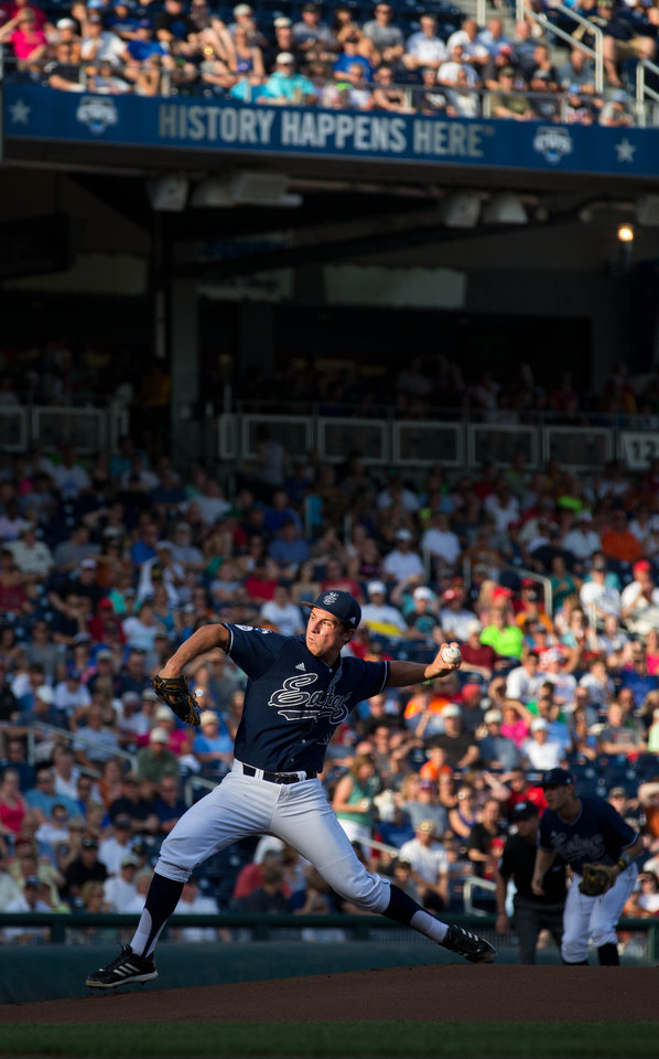 Photo - UC Irvine starting pitcher Evan Manarino throws in the first inning against Texas of an NCAA baseball College World Series elimination game in Omaha, Neb., on Wednesday, June 18, 2014. (AP Photo/The World-Herald, Chris Machian) MAGS OUT; ALL NEBRASKA LOCAL BROADCAST TV OUT.