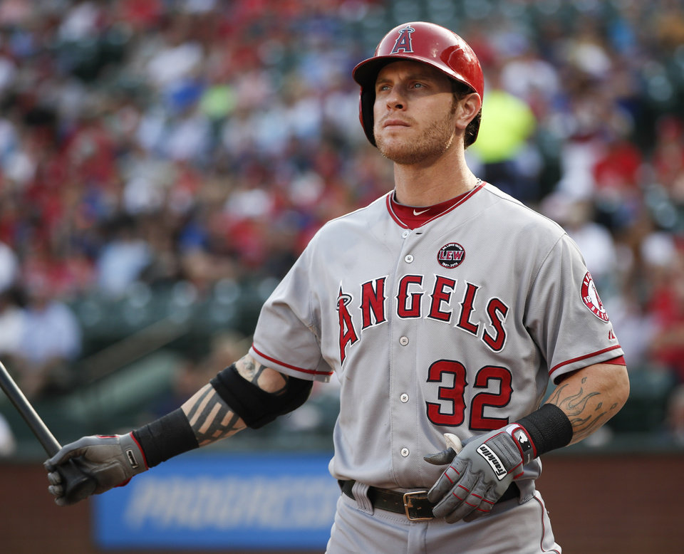 Photo - Los Angeles Angels' Josh Hamilton waits his turn to bat against the Texas Rangers during the first inning of a baseball game, Monday, July 29, 2013, in Arlington, Texas. (AP Photo/Jim Cowsert)