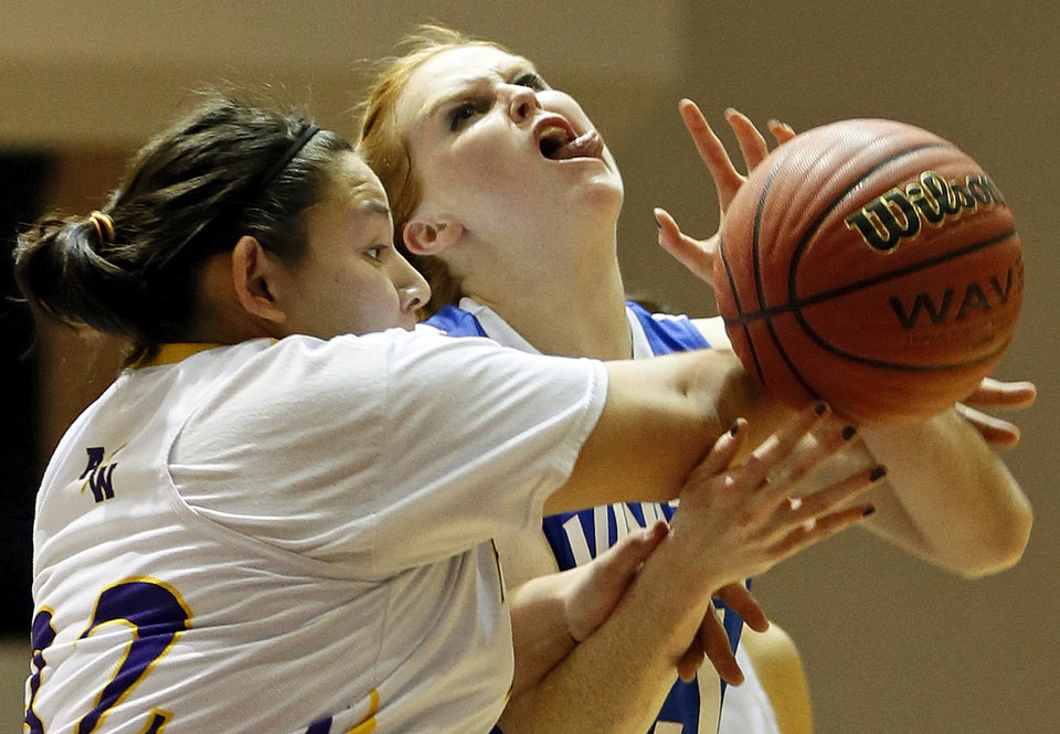 Photo - Anadarko's Kelia Pahcoddy (32), left, fouls Vinita's Carsyn Spurgeon (21) during a Class 4A girls high school basketball game in the first round of the state tournament at the Sawyer Center on the campus of Southern Nazarene University in Bethany, Okla., Thursday, March 7, 2013. Anadarko won, 51-45. Photo by Nate Billings, The Oklahoman