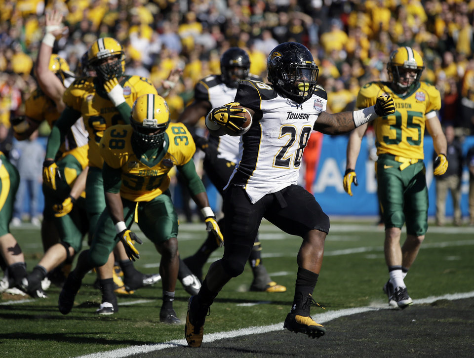 Photo - Towson running back Terrance West (28) steps into the end zone for a touchdown against North Dakota State in the first half of the FCS championship NCAA college football game, Saturday, Jan. 4, 2014, in Frisco, Texas. (AP Photo/Tony Gutierrez)