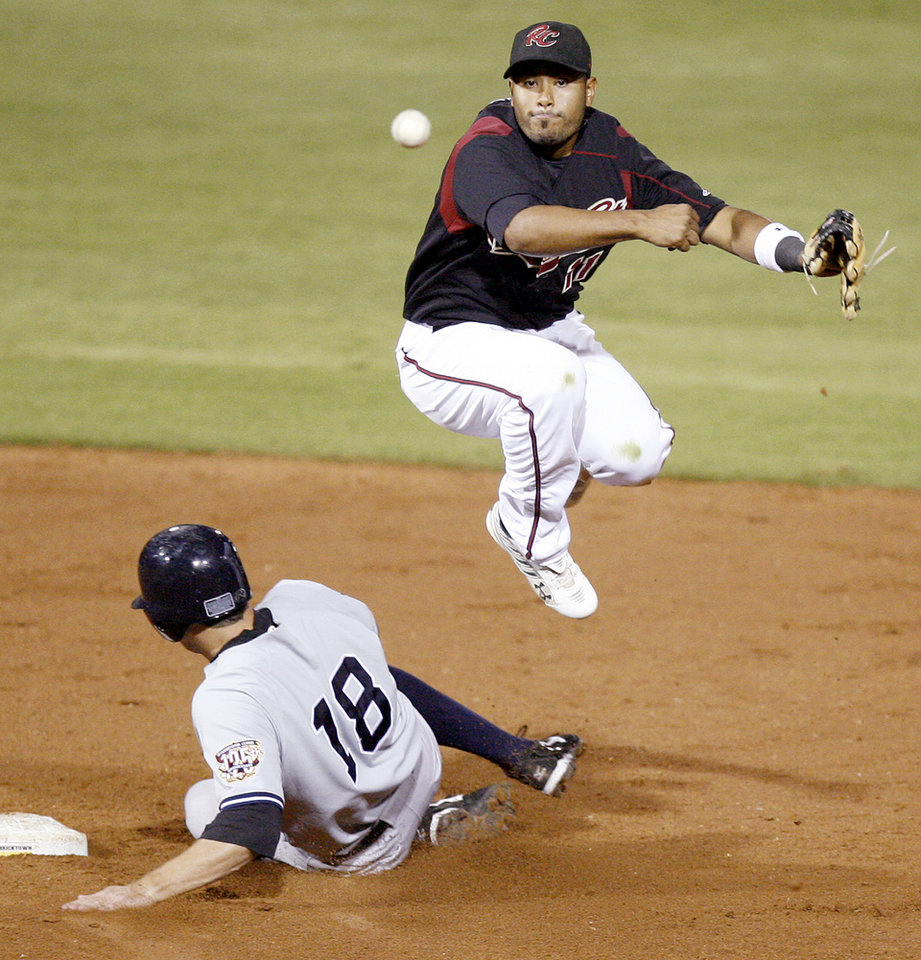 After forcing out Chris Basak of Scranton, Sacramento\'s Gregorio Petit throws back to first to complete a double play in the third inning of the Triple-A Championship game at the AT&T Bricktown Ballpark in Oklahoma City, Tuesday, September 16, 2008. BY BRYAN TERRY, THE OKLAHOMAN