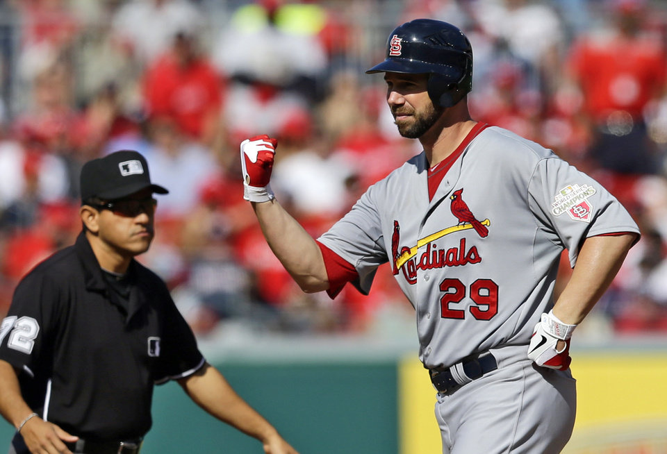 Photo -   St. Louis Cardinals starting pitcher Chris Carpenter reacts after hitting a double in the fifth inning of Game 3 of the National League division baseball series against the Washington Nationals on Wednesday, Oct. 10, 2012, in Washington. (AP Photo/Alex Brandon)