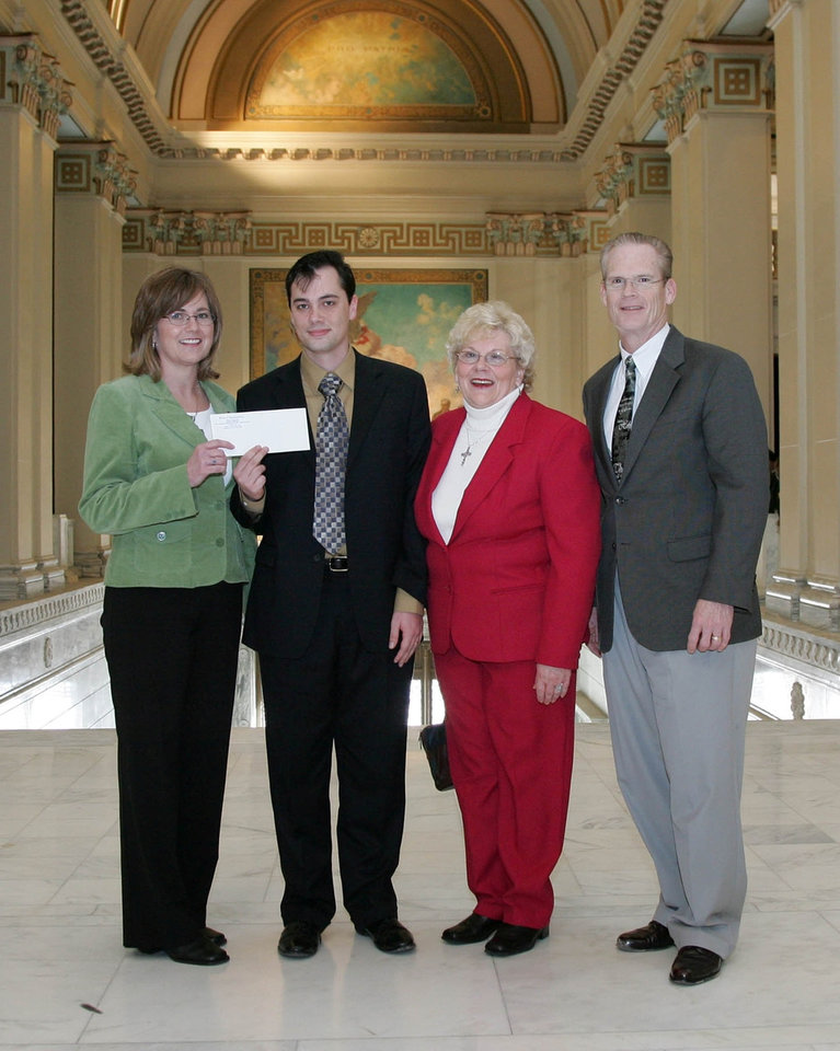 State Representative Jason Murphey (R-Guthrie) presents a donation of $8492.00 to Linda Stewart executive director of Crossroads, An Open Door for Life Choices. Murphey used the occasion of the donation to call on the legislature to approve HJR1007 which would lower the salaries of Oklahoma legislators to that made by the average Oklahoman.    included in photo are Linda Stewart,Jason Murphey,Marge Boyles and Keith Gordon.<br/><b>Community Photo By:</b> House<br/><b>Submitted By:</b> Shannon, Guthrie
