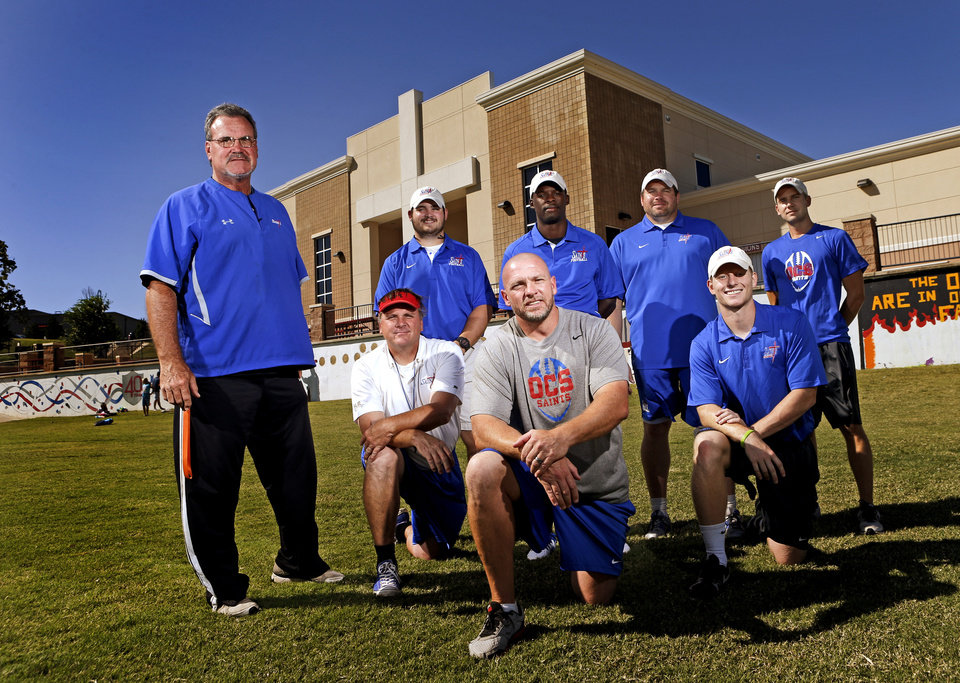 Oklahoma Christian School football coaches, standing from left, Ted Wild, Harrison Turner, Willie Ward, head coach Derek Turner, and Zach Holland, kneeling from left are Dan Fallon, Farrold Smith, and Tucker Holland in Edmond, Okla., Tuesday, September 24, 2013. Photo by Bryan Terry, The Oklahoman KOD