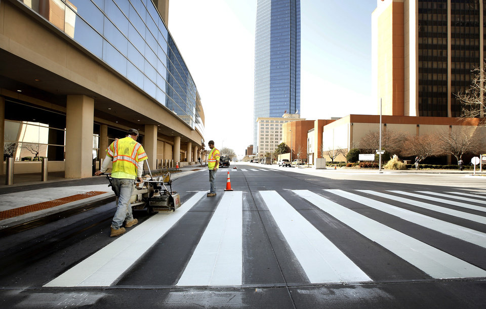 Workers with Direct Traffic Control paint new crosswalks at the intersection of Sheridan and Broadway on the north side of the Cox Convention Center,  Monday, March 4, 2013. Major street improvements were made in the area in the past months and workers are completing parts of the project by adding crosswalk markings.  Photo by Jim Beckel, The Oklahoman