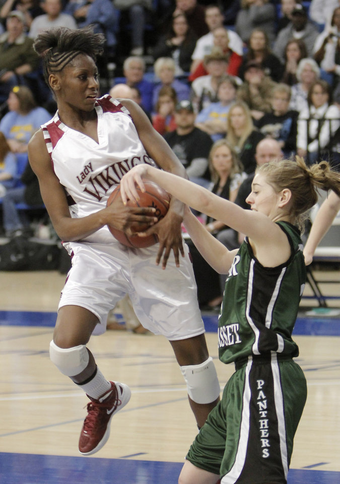 A-P #3 Jordan Garner defends against NE #1Lanesia Williams during a 2A girls high school semi-final basketball game between Northeast and Amber-Pocasset at Oklahoma City University Thursday , March 8, 2012. Photo by Doug Hoke, The Oklahoman