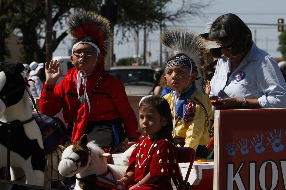 Kiowa Kids ride on a float through downtown Oklahoma City during the Red Earth parade on Friday, June 7, 2013. Photo by Aliki Dyer, The Oklahoman
